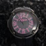 reloj negro y rosa de caucho
