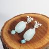 pendientes con gemas de color azul